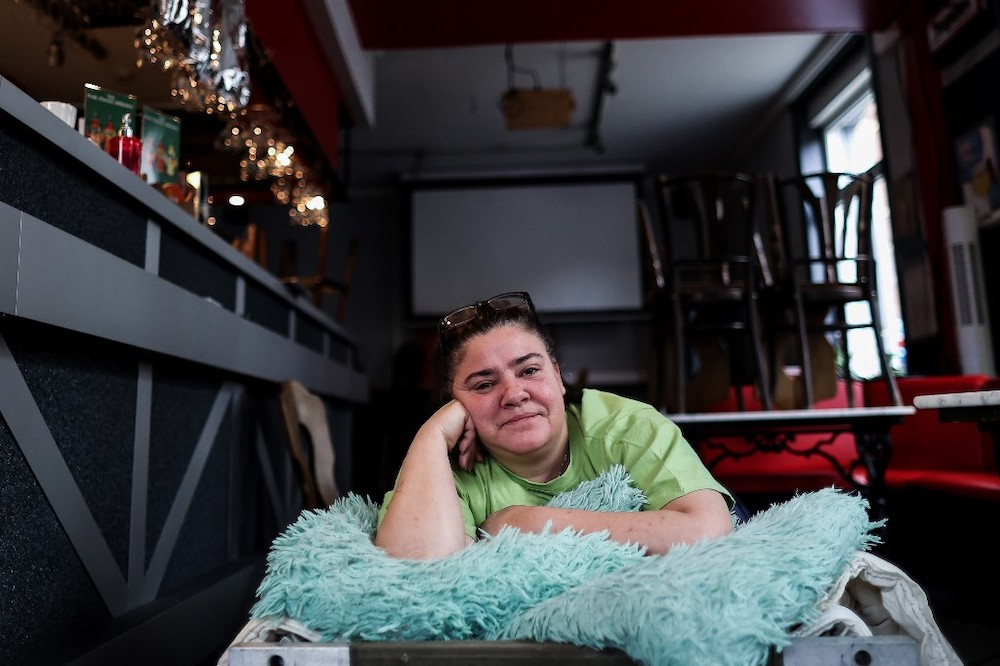 Christelle Carion, 48 years old, manager of the cafe 'Amon nos autes' in Pepinster poses in her cafe, on January 15, 2021, where she has been sleeping to protest against the closure of the bars and restaurants in Belgium as part of the measures adopte