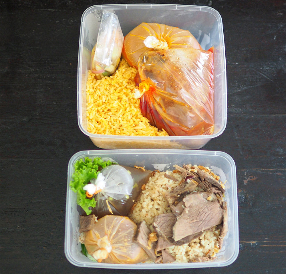 The 'nasi tomato' and 'nasi daging' are neatly packed with the liquid items in separate packets.