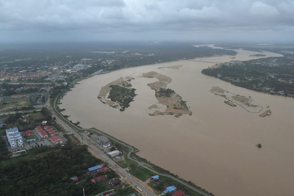 Flooding has seen swollen river banks, making transportation via road difficult. — Bernama pic