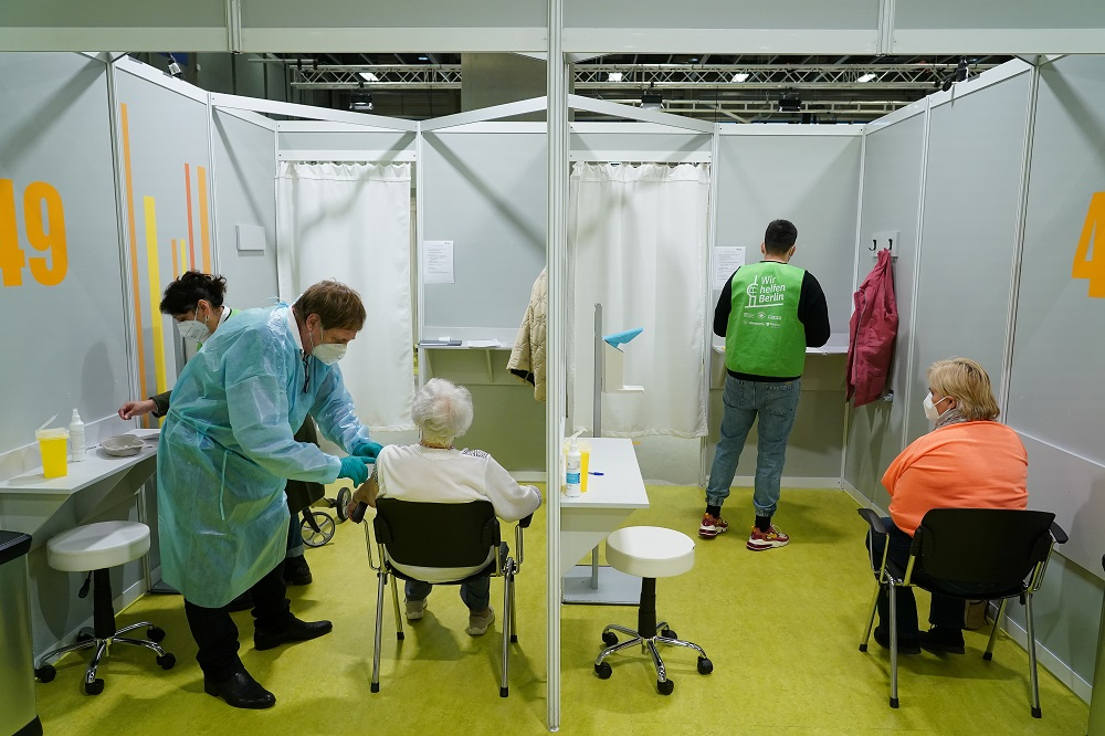 Elderly people are inoculated against the coronavirus disease on the opening day of a vaccination centre at the Messe Berlin trade fair grounds in Berlin, Germany January 18, 2021. ― Reuters pic