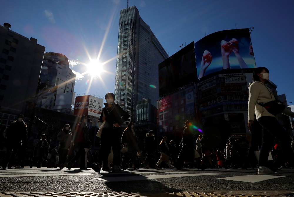 Passersby wearing protective face masks walks at Shibuya crossing after the government declared the second state of emergency for the capital and some prefectures, amid coronavirus disease outbreak, in Tokyo January 9, 2021. ― Reuters pic