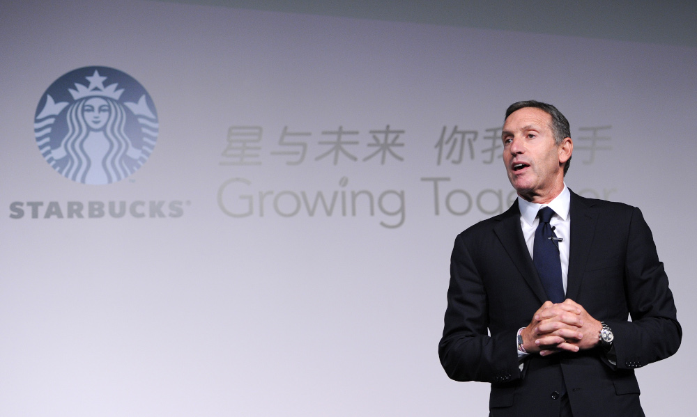 This file photo taken April 18, 2012 shows Howard Schultz, president and chief executive officer of Starbucks, delivering his speech at the Starbucks Partner Family Forum in Beijing. — AFP pic