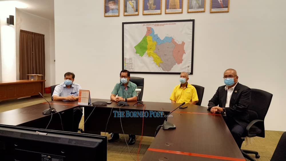 Lee (second left) during the press conference. — Borneo Post Online pic