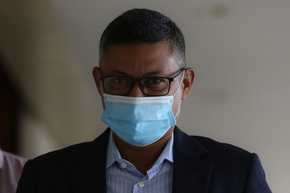 Former 1MDB CEO Mohd Hazem Abd Rahman is pictured at the Kuala Lumpur High Court January 6, 2021.  — Picture by Yusof Mat Isa