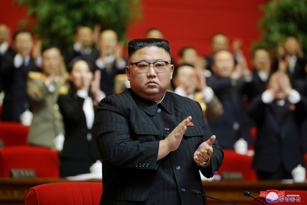 North Korean leader Kim Jong-un applauds at the 8th Congress of the Workers' Party in Pyongyang, North Korea, in this photo supplied by North Korea's Central News Agency (KCNA) January 11, 2021. — KCNA handout pic via Reuters
