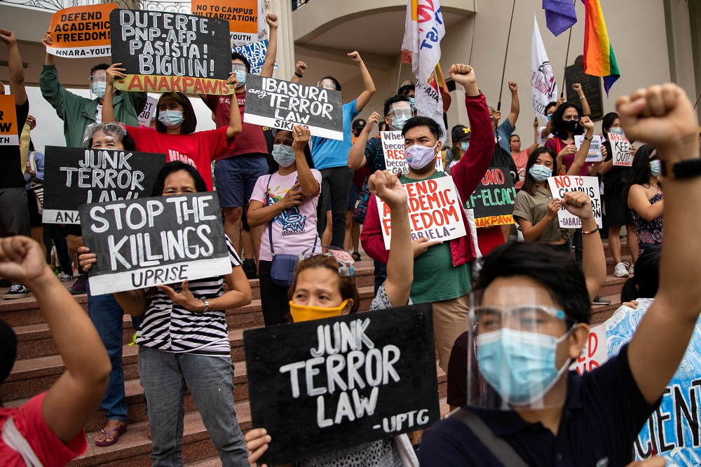 Students and activists stage a protest following the Defence Ministry's cancellation of a decades-long pact hindering police and soldiers from the country's state university, University of the Philippines in Quezon City, Metro Manila January 19, 2021. ― Reuters pic