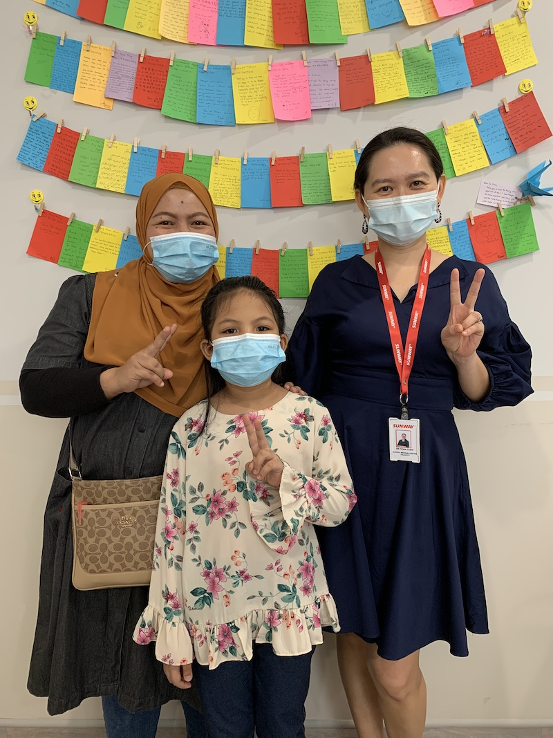 (from left) Mia's mother, Ramadiah Abd Rahman, Mia and Dr Fiona after a successful surgery leading to Mia's improved eyesight. — Photo by Jasmin Zainal