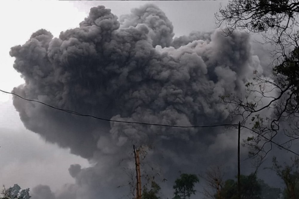 This handout photo taken and released on January 16, 2021 by the Indonesian National Board for Disaster Management (BNPB) shows Mount Semeru spewing ash during an eruption in Lumajang, East Java. — AFP pic