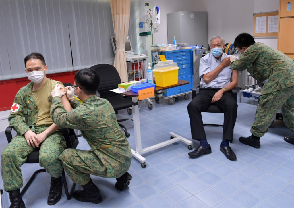 Defence Minister Ng Eng Hen (second, right) received his first dose of the vaccine on January 14, 2021. Also getting the jab was chief of the Singapore Armed Forces Medical Corps, Colonel (Dr) Lo Hong Yee (far left). ― TODAY pic