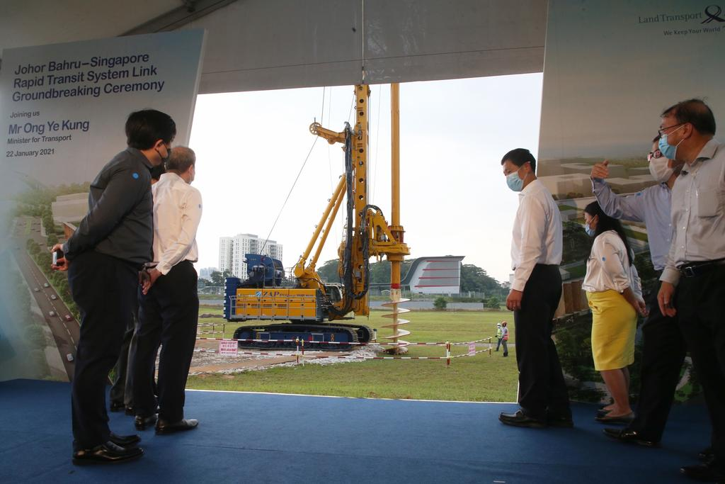 Minister for Transport Ong Ye Kung watches a rotary drilling rig drill into the ground at the Johor Baru-Singapore Rapid Transit System Link Groundbreaking Ceremony on January 22, 2021. ― TODAY pic