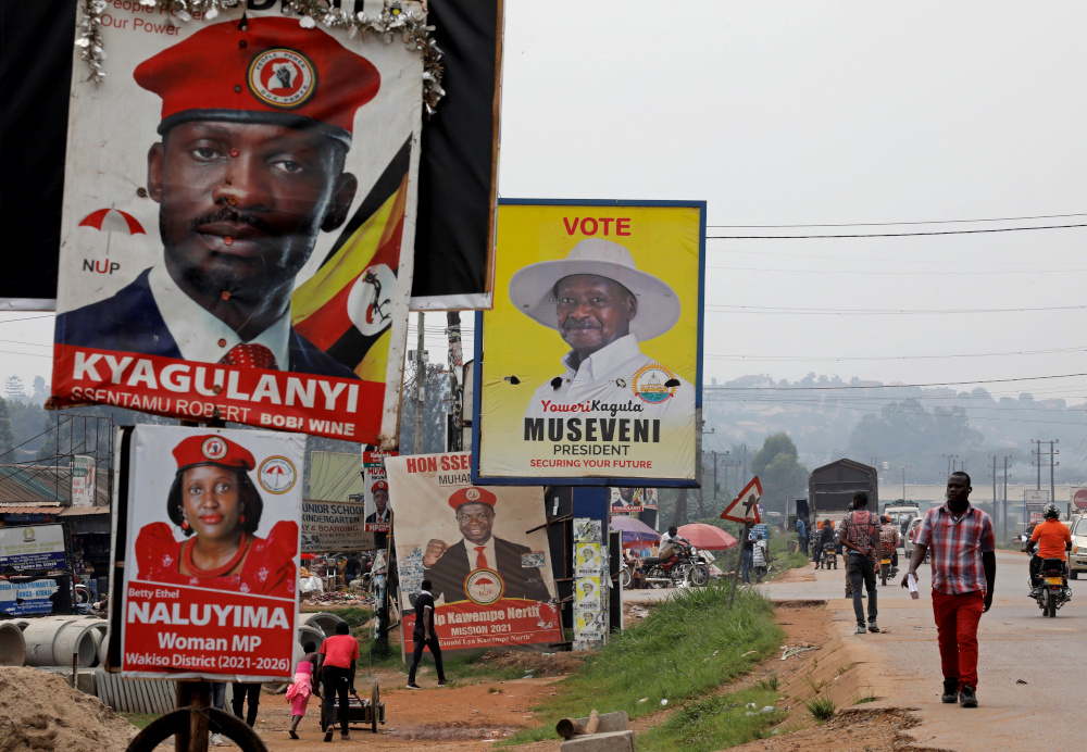 Elections billboards for Uganda's President Yoweri Museveni, and opposition leader and presidential candidate Robert Kyagulanyi, also known as Bobi Wine, are seen on a street in Kampala, Uganda January 12, 2021. — Reuters pic