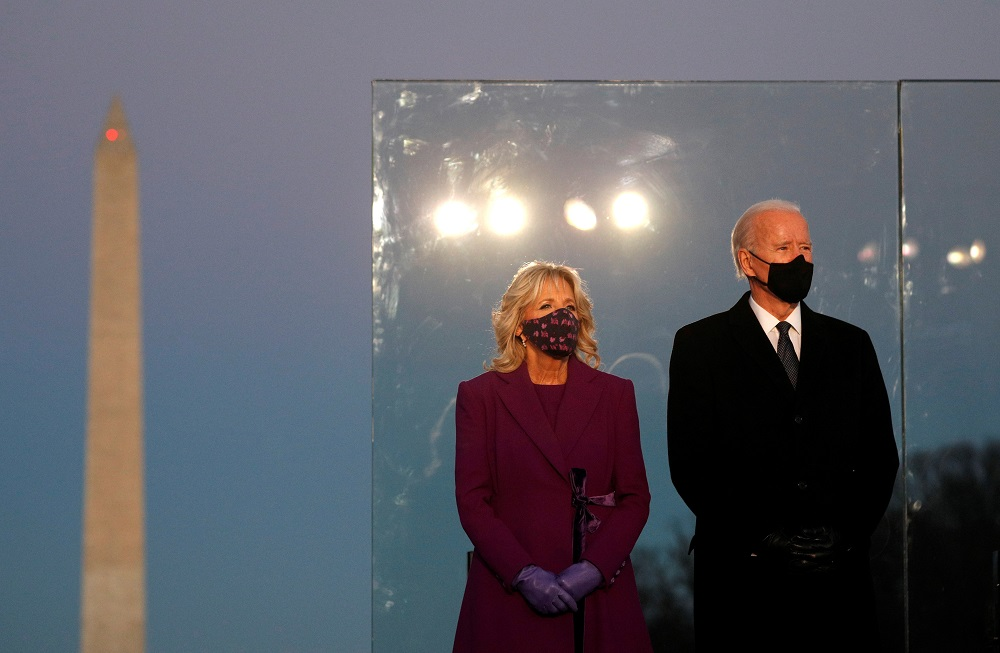 US President-elect Joe Biden and his wife Jill Biden attend a Covid-19 memorial event at the Lincoln Memorial in Washington January 19, 2021. ― Reuters pic
