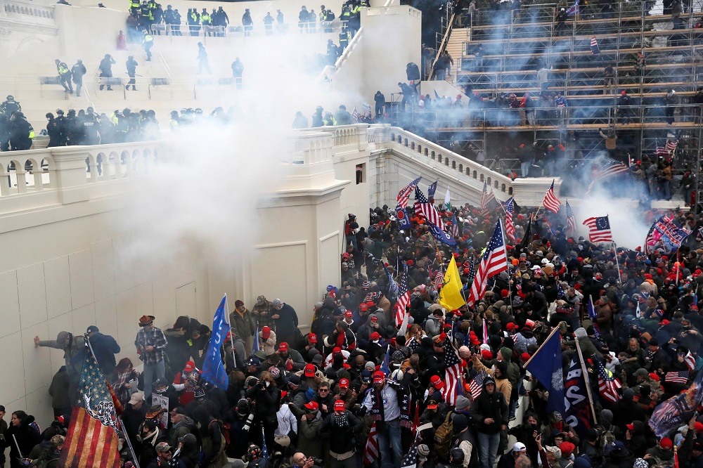 Police release tear gas into a crowd of pro-Trump protesters during clashes at a rally to contest the certification of the 2020 US presidential election results by the US Congress in Washington January 6, 2021. ― Reuters pic