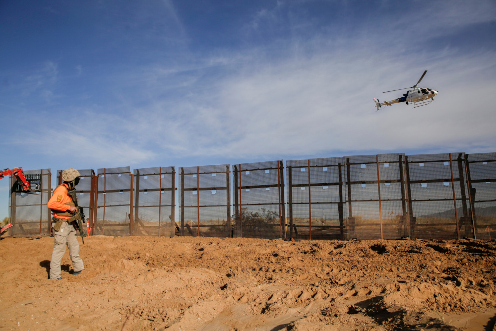A helicopter of the US Customs and Border Protection flies over the construction site where a border fence is being removed, which will be replaced by a new section of the border wall in Sunland Park, New Mexico, US, as seen from the Mexican side of the border in Ciudad Juarez, Mexico January 8, 2021. — Reuters pic