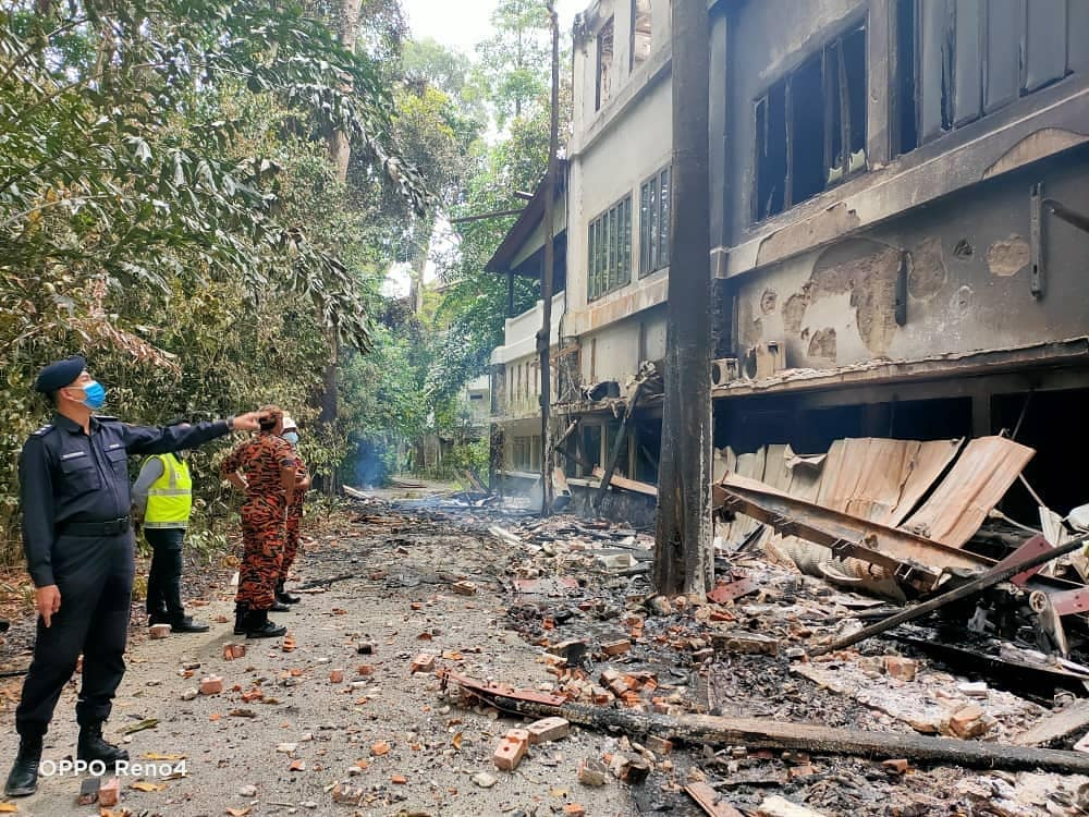 Police and Fire Dept personnel inspect the damage to The Andaman resort in Langkawi which caught fire twice yesterday. ― Picture via Facebook