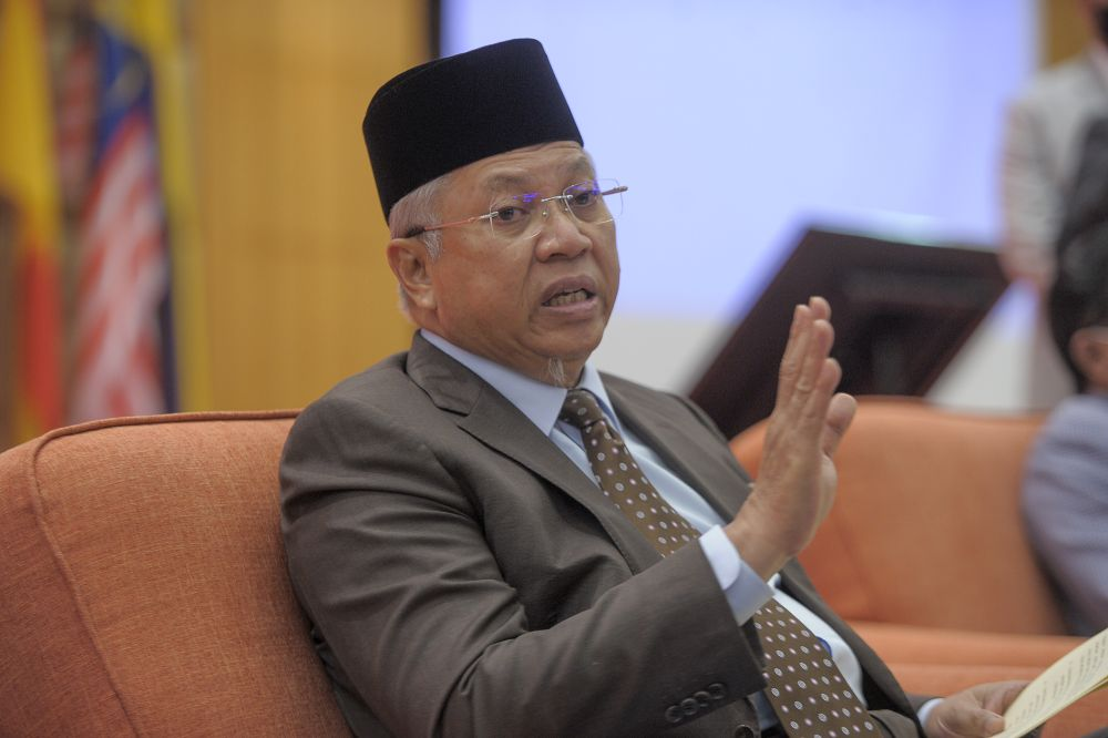 File photo of Tan Sri Annuar Musa speaking during a press conference in Putrajaya January 6, 2021. — Picture by Shafwan Zaidon
