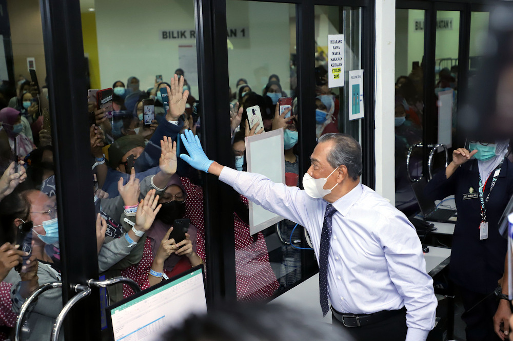 Prime Minister Tan Sri Muhyiddin Yassin meets Covid-19 patients at the MAEPS 2.0 Integrated Hospital in Serdang January 19, 2021. — Bernama pic