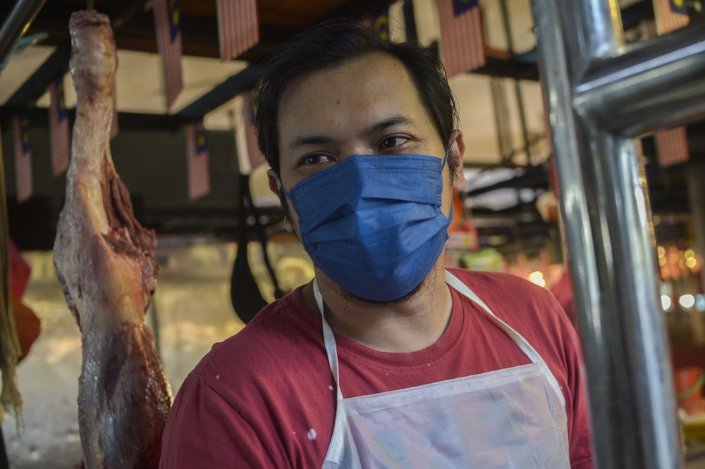 Abu says many prefer imported meat because local grown meats are more expensive. — Picture by Miera Zulyana