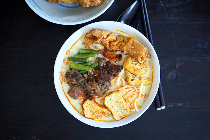 Mix the curry laksa together with the 'sambal' to get a bright orange hue and a slightly sweet tasting broth — Pictures by Lee Khang Yi