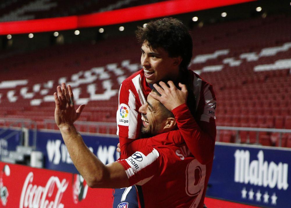 Atletico Madrid's Luis Suarez celebrates scoring their second goal with Joao Felix against Valencia at the Wanda Metropolitano, Madrid January 24, 2021. — Reuters pic