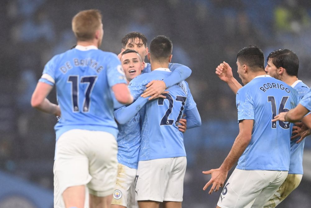 Manchester City's Phil Foden celebrates scoring their first goal against Brighton with teammates at the Etihad Stadium, Manchester January 13, 2021. — Reuters pic