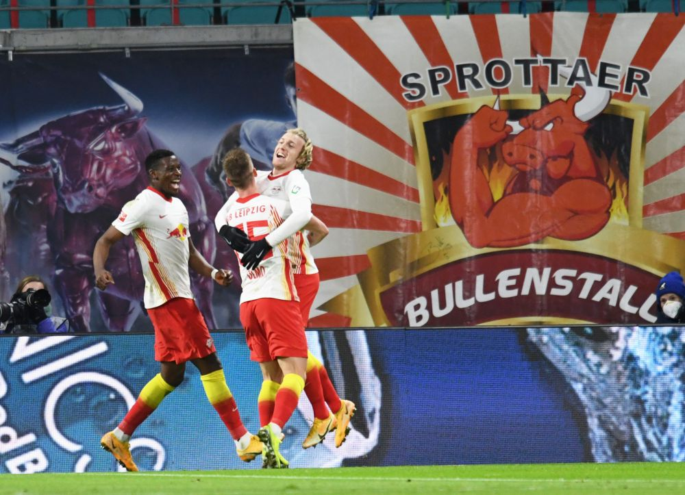 Leipzig's Emil Forsberg (right) celebrates scoring their first goal against FC Union Berlin with Dani Olmo and Nordi Mukiele at the Red Bull Arena, Leipzig January 20 2021. — Reuters pic