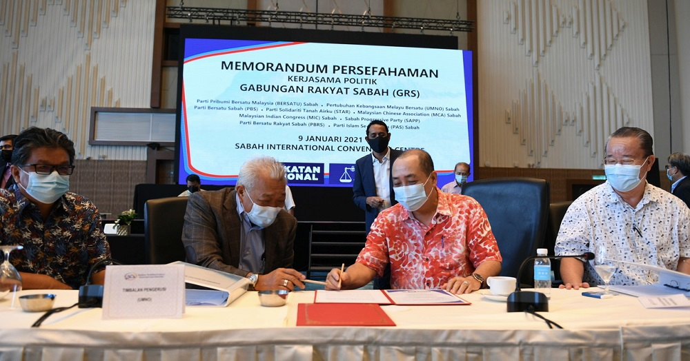 Sabah Chief Minister Datuk Hajiji Noor (second, right) and Deputy Chief Minister Datuk Seri Bung Moktar Radin (second, left) sign the memorandum of understanding in Kota Kinabalu January 9, 2021. ― Bernama pic