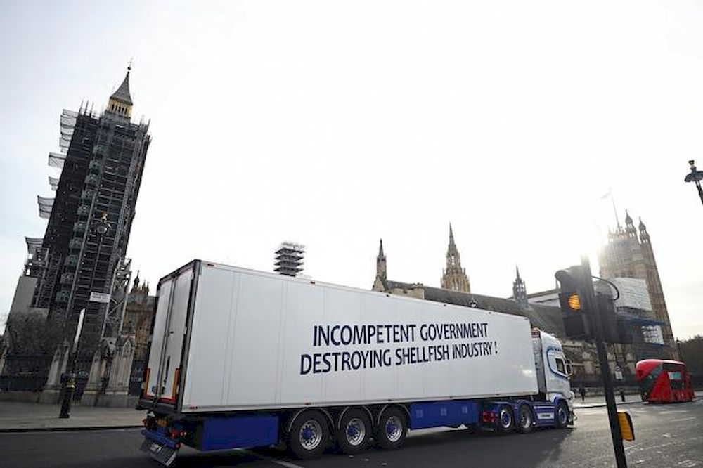 A lorry with a sign in protest against post-Brexit bureaucracy that hinders exports to the European Union, drives at the Parliament Square in London, Britain, January 18, 2021. — Reuters pic