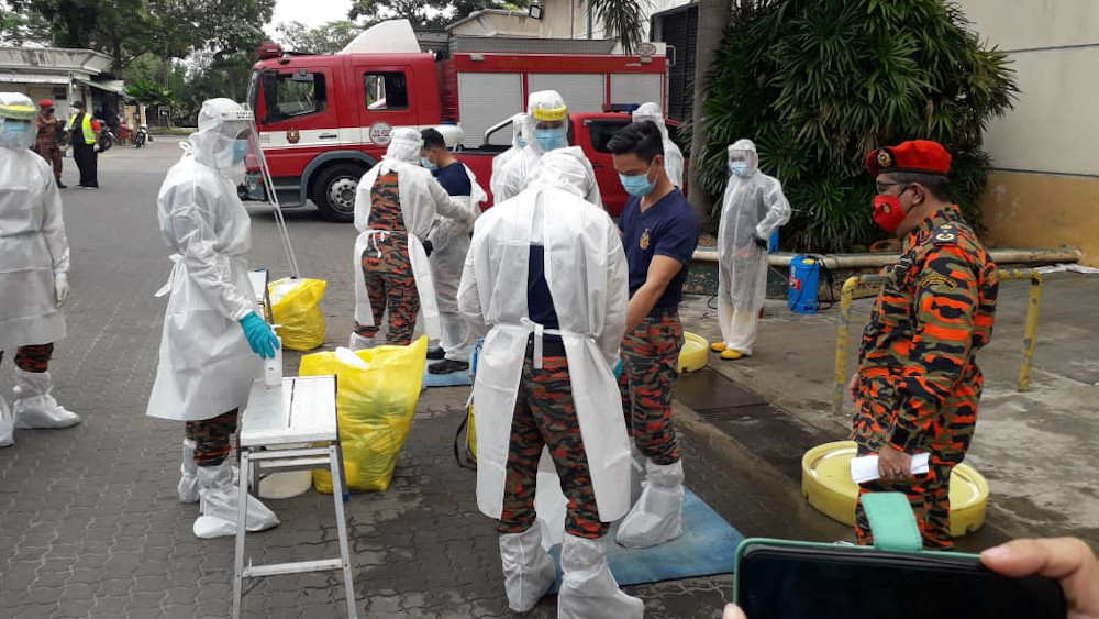 Johor Fire and Rescue Department personnel preparing to conduct a sanitisation operation at the Pandan wholesale market in Johor Baru tosay. — Picture by Ben Tan