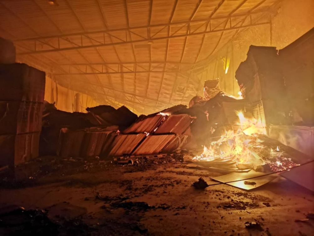 Firemen took three days to contain the blaze at the warehouse on Jalan Jorak in Bukit Pasir, Muar recently. — Picture courtesy of the Johor Fire and Rescue Department