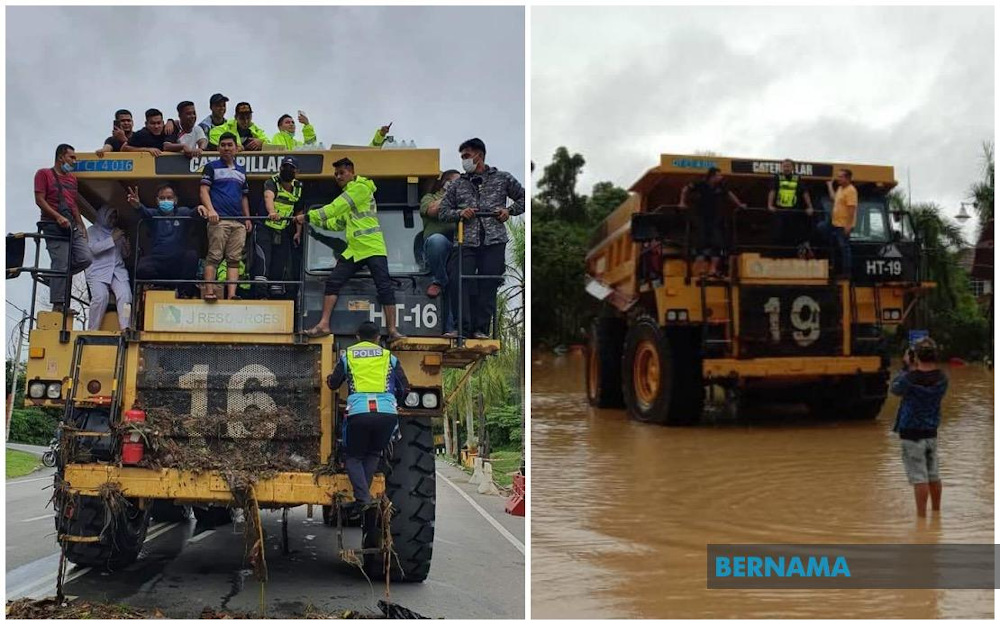 Police in Lipis asked for the help of Sadri Asreil Sahair's heavy machinery, dubbed 'King Kong' to rescue flood victims due to rising floodwaters. — Picture via Twitter/Bernama