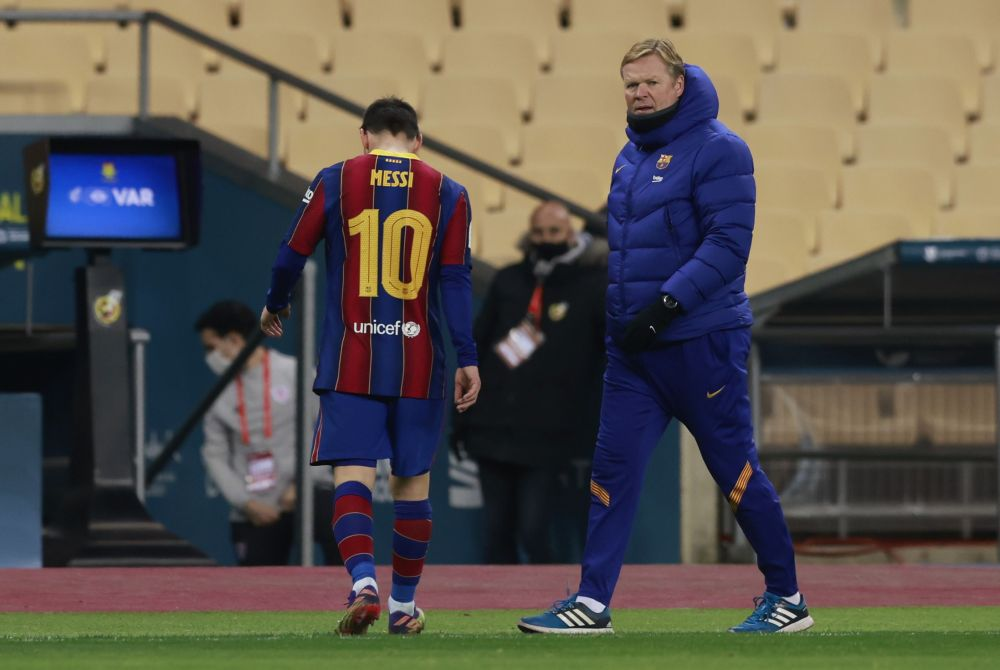 Barcelona coach Ronald Koeman is pictured as Lionel Messi walks off the pitch after being sent off against Athletic Bilbao at Estadio La Cartuja de Sevilla January 17, 2021. — Reuters pic