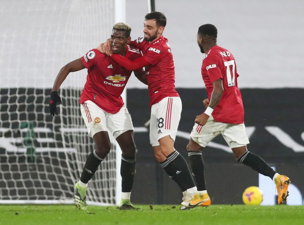 Manchester United's Paul Pogba celebrates scoring their second goal against Fulham with Paul Pogba at Craven Cottage, London January 20 2021. — Reuters pic