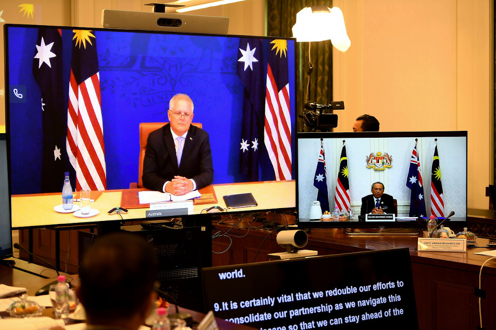 Prime Minister Tan Sri Muhyiddin Yassin and his Australian counterpart Scott John Morrison during the Malaysia-Australia Comprehensive Strategic Partnership Meeting which took place in a video conference at Perdana Putra January 27, 2021. — Bernama pic