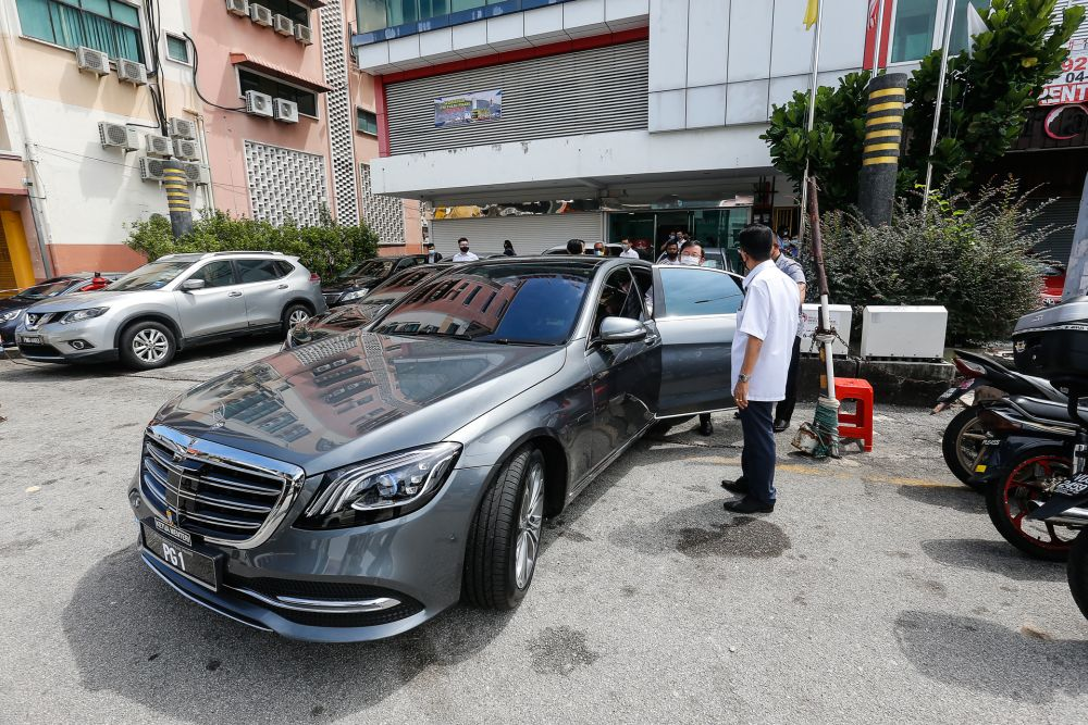 Penang Chief Minister Chow Kon Yeow alights from the brand new Mercedes-Benz S560e at Wisma DAP in George Town January 7, 2021. — Picture by Sayuti Zainudin