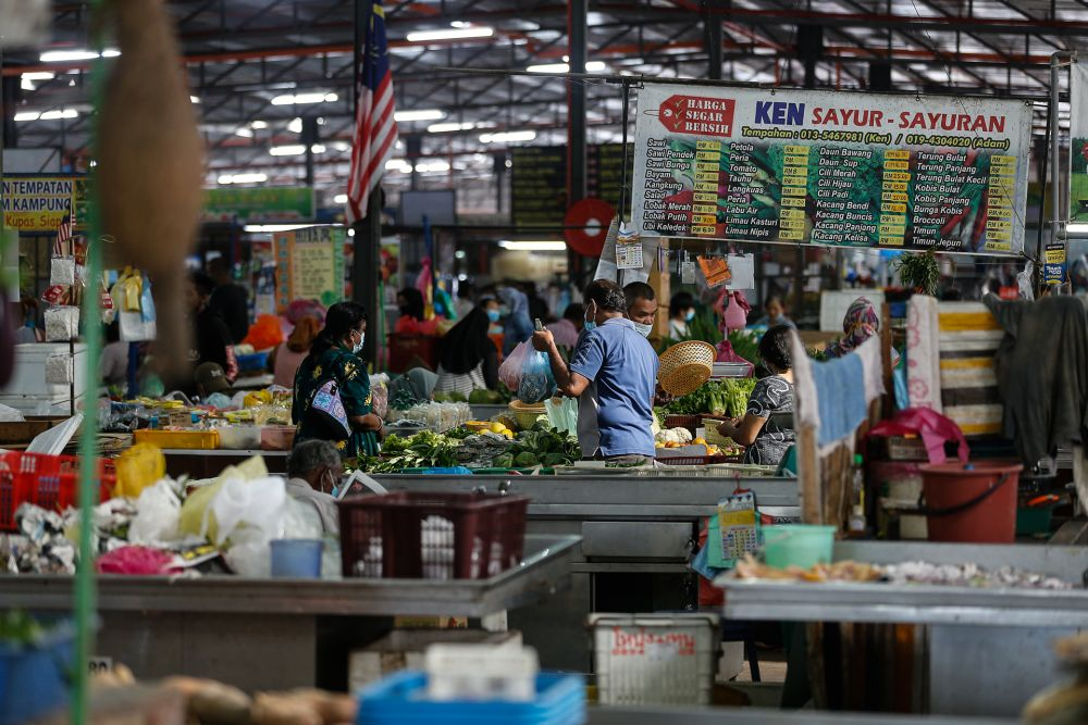 People are seen shopping for groceries on the eve of MCO 2.0 here at the Seberang Jaya Wet Market in Penang January 12, 2021. — Picture by Sayuti Zainudin