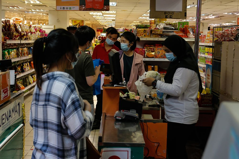 People are seen calmly shopping for provisions on the eve of MCO 2.0 here at a supermarket in Bayan Baru January 12, 2021. — Picture by Sayuti Zainudin