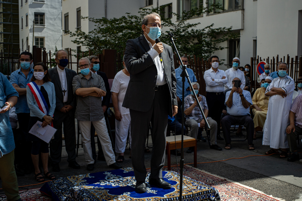 The president of the CFCM (French Council of Muslim Worship) Mohammed Moussaoui delivers a speech at a rally in front of the Essalem Mosque, victim of arson in Lyon, on August 14, 2020. — Reuters pic