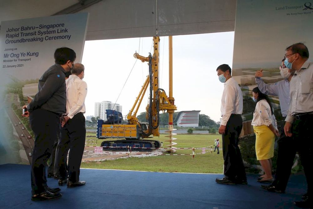 Minister for Transport Ong Ye Kung watches a rotary drilling rig drill into the ground at the Johor Bahru-Singapore Rapid Transit System Link Groundbreaking Ceremony on Jan 22, 2021. — TODAY pic