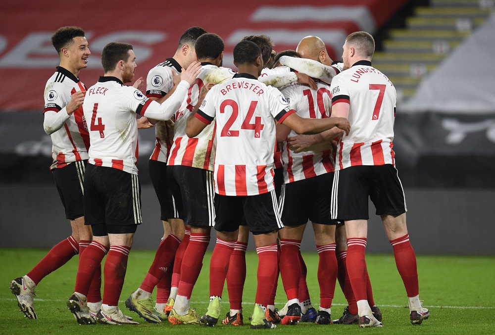 Sheffield United's Billy Sharp celebrates with teammates after scoring the first goal against Newcastle United January 13, 2021. ― Pool via Reuters