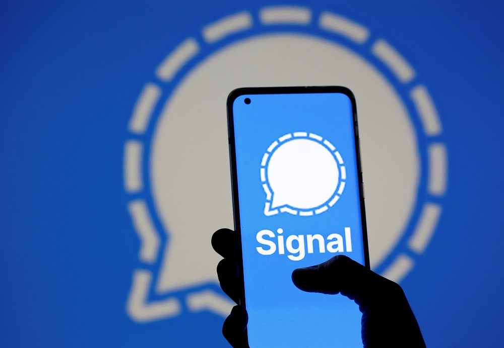 The Signal messaging app logo is seen on a smartphone, in front of the same displayed same logo, in this illustration taken, January 13, 2021. ― Reuters pic
