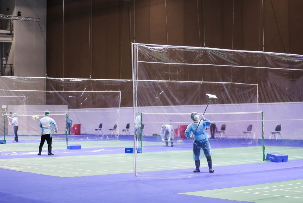 Workers disinfect the courts where the Yonex Thailand Open Badminton tournament is taking place at the Impact Arena in Bangkok January 6, 2021. ― Reuters pic