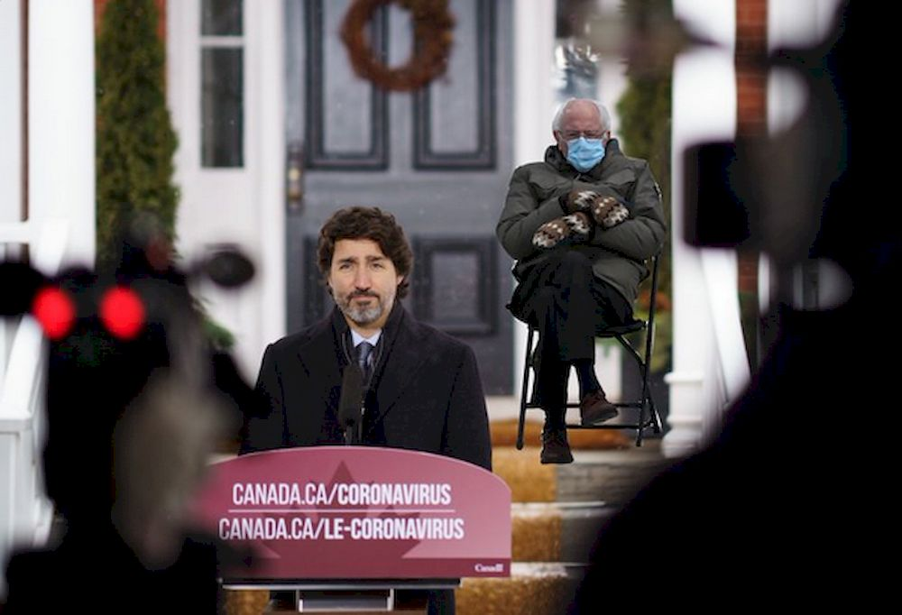 Canadian Prime Minister Justin Trudeau posted a photo of himself giving a press conference from his lawn with the image of a seated, mitten-clad Bernie Sanders superimposed in the background. — Picture via Twitter@JustinTrudeau