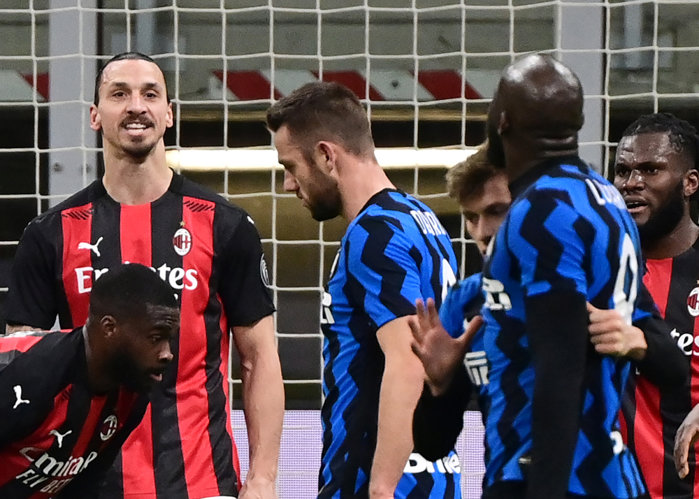 AC Milan forward Zlatan Ibrahimovic argues with Inter Milan forward Romelu Lukaku at the end of the first half of the Italian Cup quarter final football match between Inter Milan and AC Milan January 26, 2021 at the Meazza stadium in Milan. — AFP pic