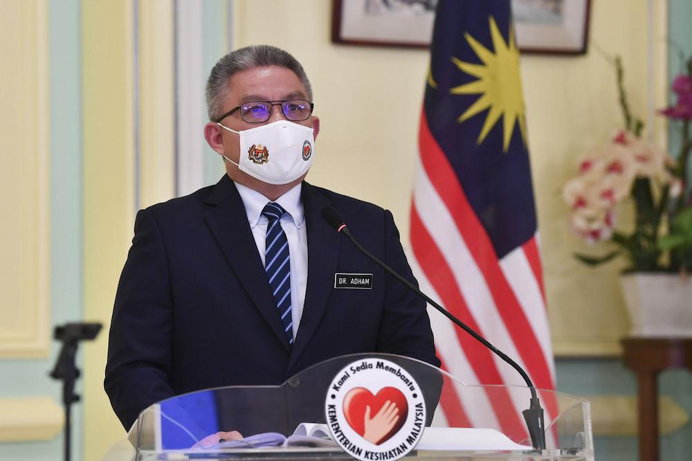 Dr Adham Baba addresses a press conference in Putrajaya February 16, 2021. — Bernama pic