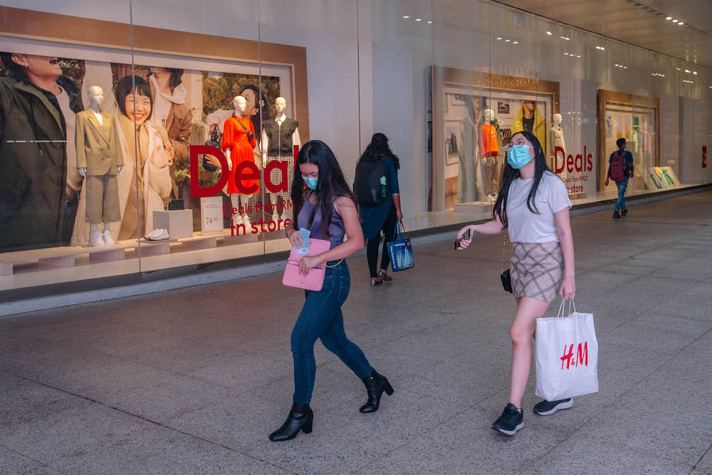 People wearing face masks are seen walking outside a shopping mall in Kuala Lumpur amid the Covid-19 outbreak, February 16, 2021. — Picture by Firdaus Latif