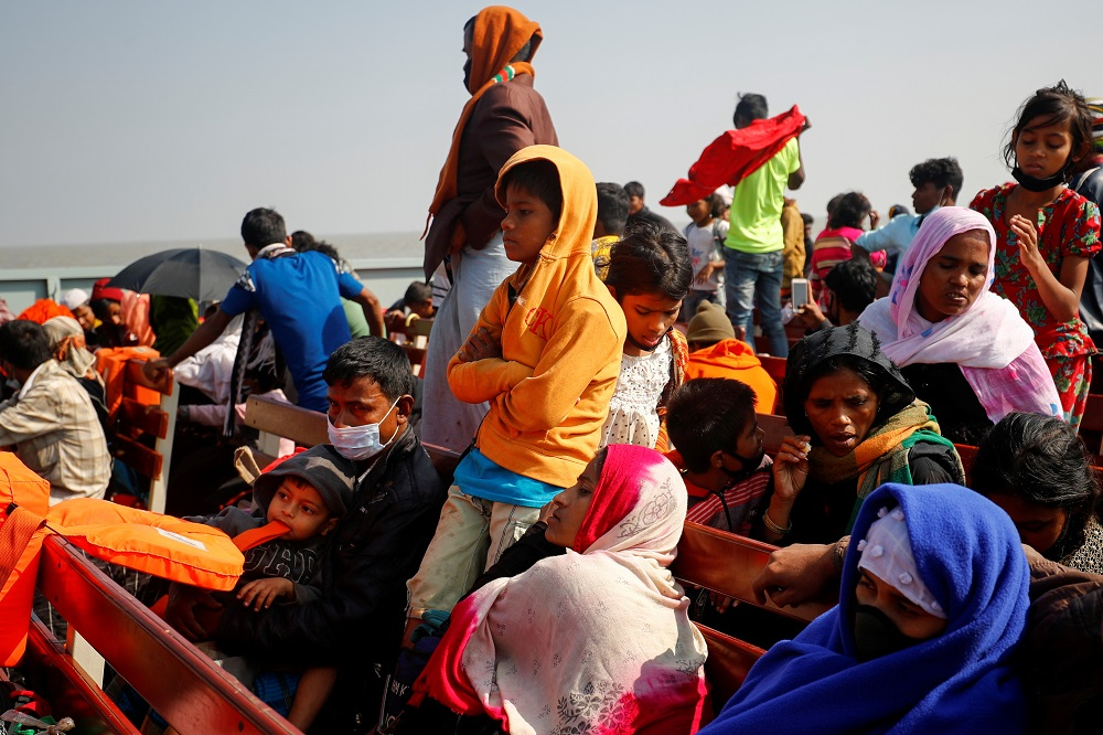 Rohingya refugees sit on wooden benches of a navy vessel on their way to the Bhasan Char island in Noakhali district, Bangladesh December 29, 2020. — Reuters pic