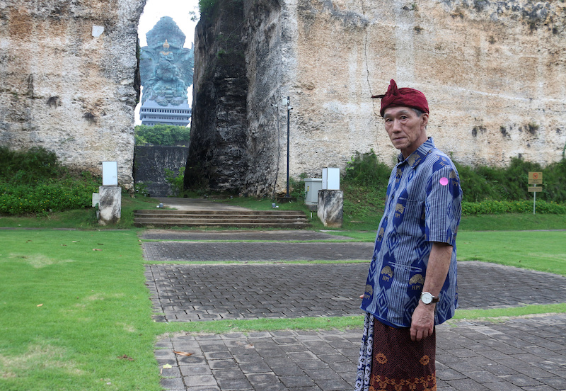 Effendy, a 65-year-old ethnic Chinese tour guide who also uses the name Lin Wen Hui, poses for pictures at Garuda Wisnu Kencana Cultural Park in South Kuta, Bali January 31, 2021. — Reuters pic
