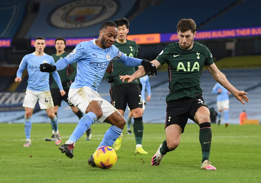 Manchester City's Raheem Sterling in action with Tottenham Hotspur's Ben Davies during the match at the Etihad Stadium in Manchester February 13, 2021. — Pool pic via Reuters