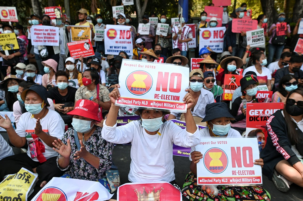 Demonstrators hold placards during a rally against the military coup in front of Indonesian embassy in Yangon February 24, 2021. — Reuters pic